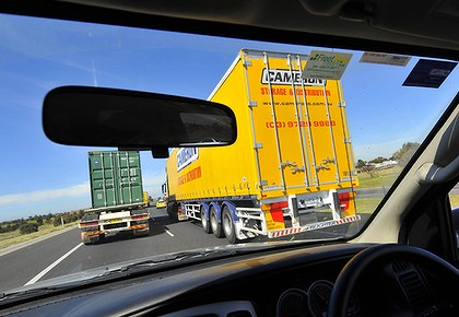 Driving along one of Melbourne's truck-laden freeways yesterday: not for the faint-hearted or the claustrophobic. Photo: Wayne Taylor of the Age